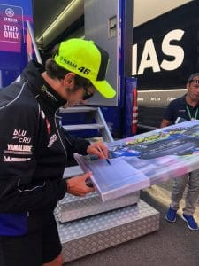 Valentino Rossi Signing the canvas